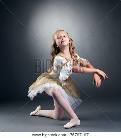 Image of nice little ballerina posing at camera
