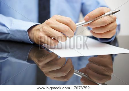 Closeup Of Business Man Reading Document Or Contract