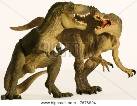A Spinosaurus and Tyrannosaurus Battle Against White