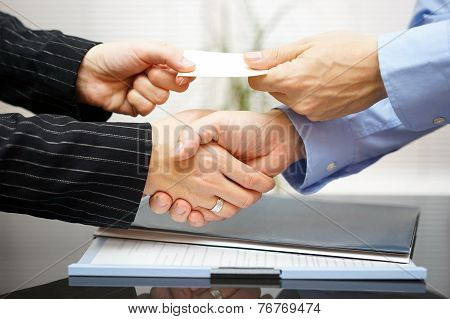 Business Clients Are Exchanging Business Card  And Handshakeing After Successful Meeting