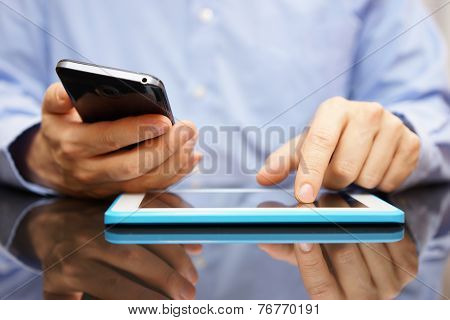 Male Is Using Smart Mobile Phone And Tablet Computer At The Same Time