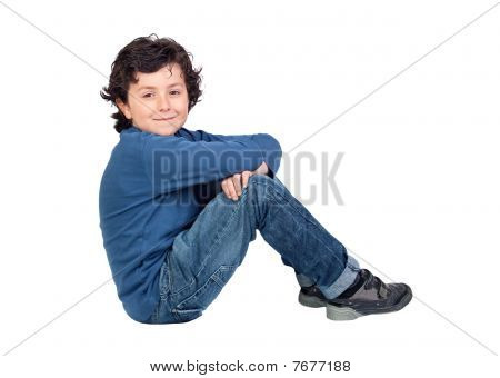Adorable Child Sitting On The Floor