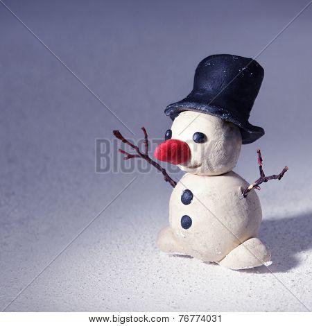 plasticine snowman on snow, christmas children hand made