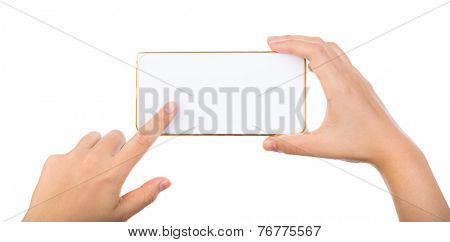 Female hand holding gold mobile phone smartphone mock up with blank screen isolated on white background