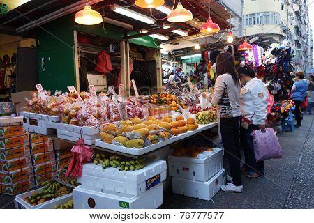 Shoppers Buy Fruits At Kowloon City Market In Hong Kong