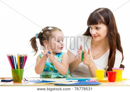 child and mom drawing with colorful pencils