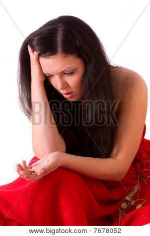 Divorce. Sad Woman Holding Gold Wedding Ring.