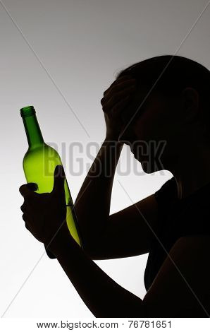 Silhouette Of A Sad Drinker