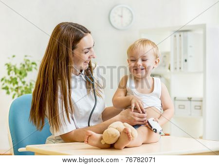 pediatrician doctor examining of kid with stethoscope