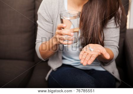 Young Woman Taking Aspirin