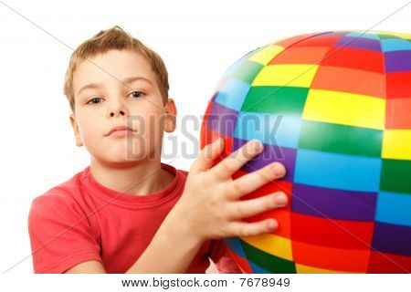 Portrait of boy with colorful inflatable ball