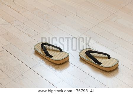 Pair Of Traditional Japanese Sandals On Old Wooden Floor.