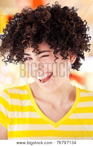 Young girl with curly hair and shirt with yellow stripes isolated with work path.