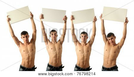 Four young sexy men showing copy space blank signs isolated on white