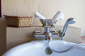 image of bath tub  - Luxury bath tub in a bathroom with towels - JPG