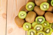 stock photo of exotic_food  - Kiwi in two halves with other kiwis on the back - JPG