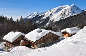 stock photo of chalet  - chalets in the mountains covered with snow - JPG