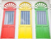 stock photo of colorful building  - The Colorful windows of the  old building - JPG