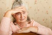 foto of grieving  - Elderly woman grieves at home - JPG