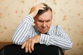picture of grieving  - Elderly man grieves at home - JPG