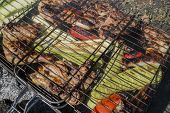 foto of marinade  - The marinaded chicken fried on coals on a lattice - JPG