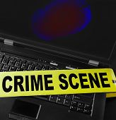 image of cybercrime  - fingerprint on a laptop with crime scene tape - JPG