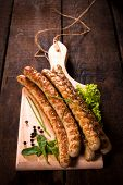 picture of grilled sausage  - Traditional German grilled sausages on wooden backgroundselective focus - JPG