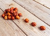 stock photo of filbert  - Stack of nuts filbert on wooden background - JPG