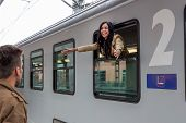 foto of long distance relationship  - parr on arrival or verabschiedeung on a platform at a station - JPG