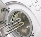 stock photo of scum  - Washing machine and old damaged electric heater - JPG