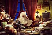 Image of santa claus reading a letter.