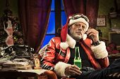 stock photo of rude  - Lazy bad Santa celebrating Christmas at home alone with cigarette and beer - JPG