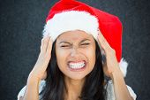 image of breakup  - Closeup portrait young beautiful worried stressed wife mother woman in santa claus hat with hands on temples about to break down isolated gray black background - JPG