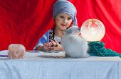 pic of fortune-teller  - little child fortune teller with her cat