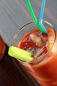 stock photo of bloody mary  - Bloody Mary cocktail on a veneered counter top. ** Note: Shallow depth of field - JPG
