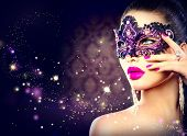 picture of female mask  - Sexy model woman wearing venetian masquerade carnival mask at party over holiday dark background - JPG