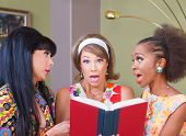 image of tawdry  - Three diverse pretty women surprised with a book - JPG