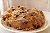 stock photo of baking soda  - A freshly baked loaf of Irish Soda Bread rests on a table ready to serve - JPG