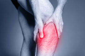 pic of calf  - Calf leg pain man holding sore and painful muscle sprain or cramp ache filled with red pink bright place - JPG