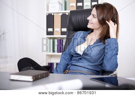 Happy Office Woman Relaxing On Chair At The Office