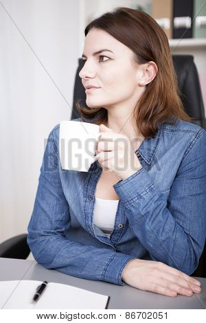 Observant Young Businesswoman Drinking Coffee