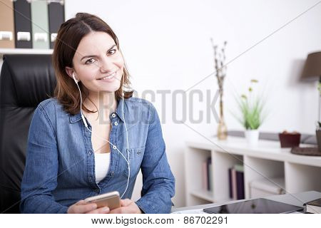Pretty Office Woman Listening Music From Phone