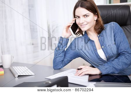 Friendly Businesswoman Smiling As She Takes A Call