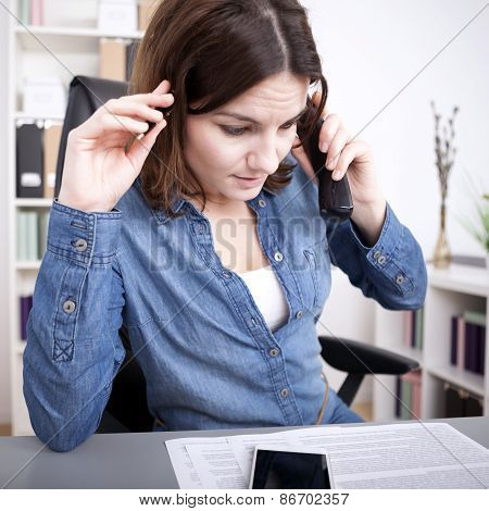 Worried Businesswoman Taking A Phone Call