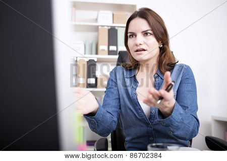 Shocked Businesswoman Facing Computer Screen