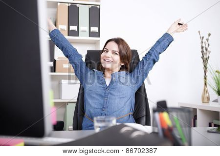 Happy Female Executive Stretching Her Arms