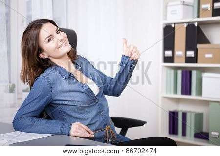 Happy Excited Woman Giving A Thumbs Up Gesture