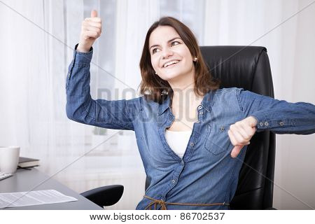 Undecided Businesswoman Doing A Thumbs Up And Down