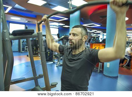 Young Man Exercise At The Gym