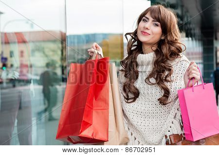 Portrait of young woman shopping